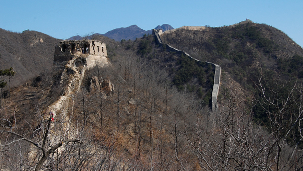Towers on the ridgeline on the wild Great Wall on the way to the Little West Lake
